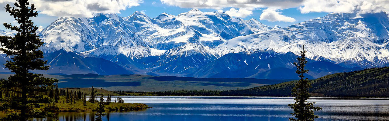 Snowy Alaskan mountains with a lake in the foreground