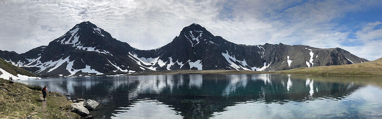 Hikers near a lake in Alaska