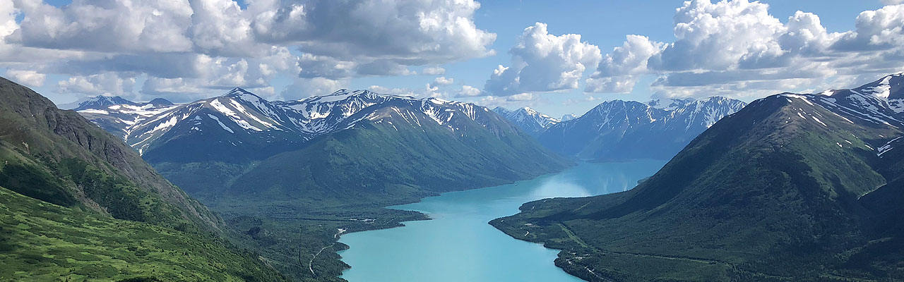 A large lake winding through mountains